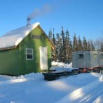 Cabin in winter with solar panel